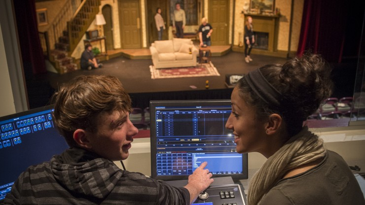 Two students running the light board for a theatre rehearsal in the Main Stage.