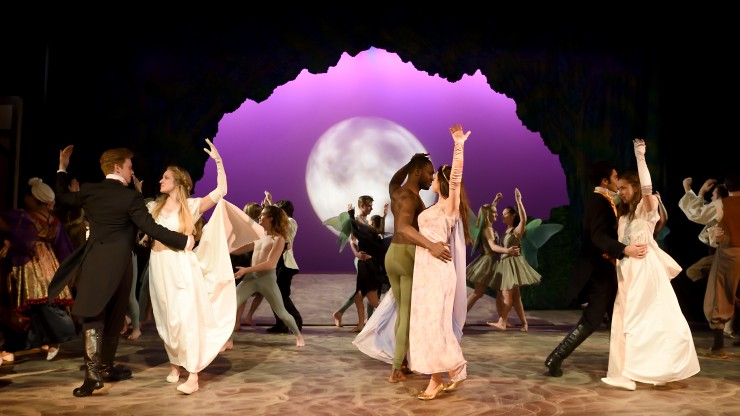 Students dancing while in costume during A Midsummer Night's Dream performance.