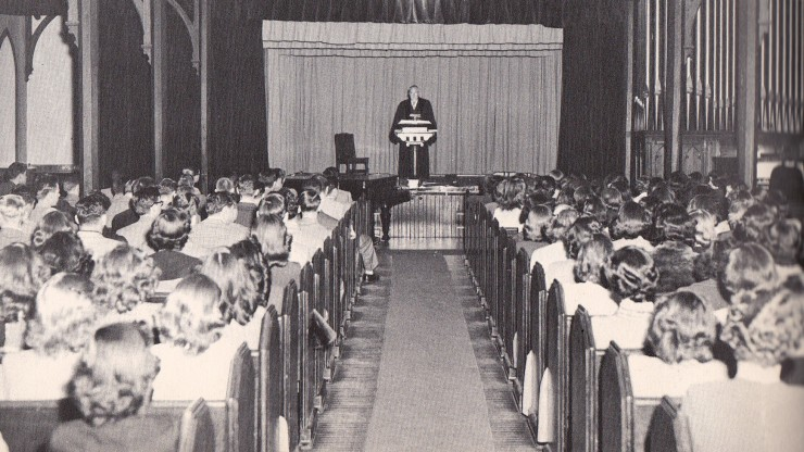 Image of students during a service being held in the marvin chapel at dean college.