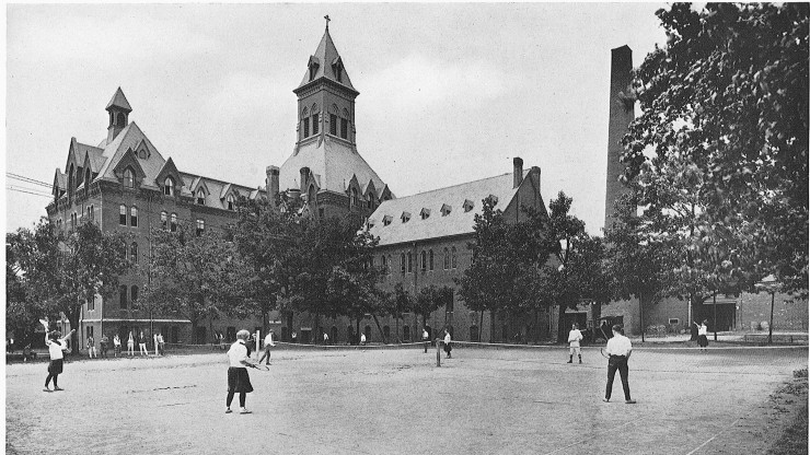 Black and white image of Tennis Courts outside of Dean Hall in the late 1800's.