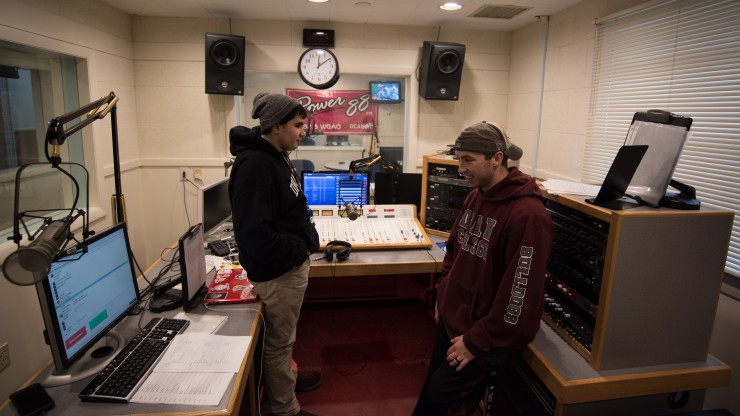 Two students working at the Power88 radio station.