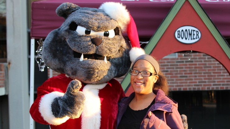 Boomer and student smiling at the camera during the Annual Tree Lighting ceremony.
