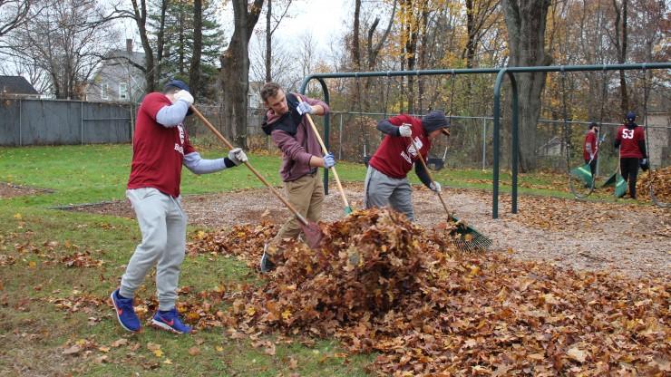 Students raking leaves at Nason Street park.